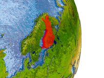 Finland on realistic globe. Finland in red on model of globe with embossed countries and realistic water. 3D illustration. Elements of this image furnished by Royalty Free Stock Image
