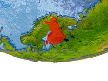 Finland in red on Earth model. Finland on 3D model of globe with real land surface, visible country borders and water in place of ocean. 3D illustration Royalty Free Stock Photos