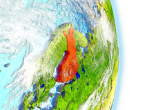 Finland in red on Earth. Finland in red on model of planet Earth. 3D illustration with highly detailed realistic planet surface and clouds. Elements of this Royalty Free Stock Images