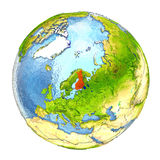 Finland in red on full Earth. Finland highlighted in red on Earth. 3D illustration with highly detailed realistic planet surface isolated on white background Stock Photo
