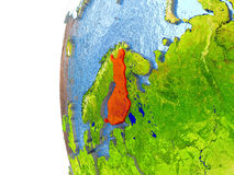 Finland in red. On a globe with reflective ocean waters. 3D illustration with highly detailed realistic planet surface. Elements of this image furnished by NASA Royalty Free Stock Photos