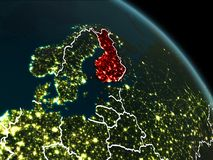Finland in red at night. Finland from orbit of planet Earth at night with visible borderlines and city lights. 3D illustration. Elements of this image furnished Stock Photography