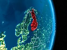Finland in red at night. Finland from orbit of planet Earth at night with visible borderlines and city lights. 3D illustration. Elements of this image furnished Stock Images