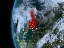 Finland in red at night. Night map of Finland as seen from space on planet Earth. 3D illustration. Elements of this image furnished by NASA Stock Image