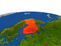 Finland in red from orbit. Finland from Earth's orbit in space highlighted in red color. 3D illustration with highly detailed realistic planet surface. Elements Stock Photos