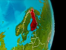 Finland on Earth. Finland in red on planet Earth with visible borderlines. 3D illustration. Elements of this image furnished by NASA Royalty Free Stock Photo