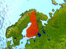 Finland in red. Top-down view of Finland highlighted in red with surrounding region. 3D illustration with highly detailed realistic planet surface. Elements of Stock Photo