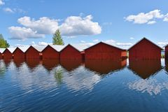 Finland. Red wooden boat houses in Kerimäki, Finland royalty free stock photo