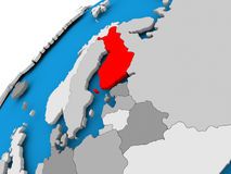 Map of Finland in red. Finland on simple political globe with visible country borders. 3D illustration Stock Images