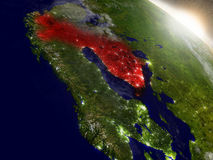 Finland from space highlighted in red. Finland highlighted in red as seen from Earth's orbit in space. 3D illustration with highly detailed planet surface Royalty Free Stock Image