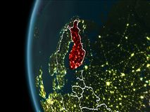 Finland from space at night. Orbit view of Finland highlighted in red with visible borderlines and city lights on planet Earth at night. 3D illustration Royalty Free Stock Image