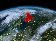Finland from space at night. Satellite night view of Finland highlighted in red on planet Earth with clouds. 3D illustration. Elements of this image furnished by Stock Photo