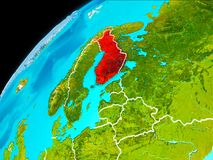 Finland from space. Orbit view of Finland highlighted in red with visible borderlines on planet Earth. 3D illustration. Elements of this image furnished by NASA Royalty Free Stock Photography