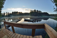 Finland summer house lake and boat Royalty Free Stock Image