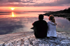 Finland: Sunset by gulf of finland. A couple is admiring a beautiful sunset on the southern coast of Finland by the Gulf of Finland