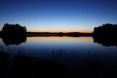 Finland: Sunset by a lake Royalty Free Stock Image