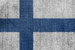 Finland Textile Industry Or Politics Concept: Finnish Flag Denim Jeans. Background Texture royalty free stock image