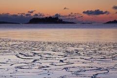 Finland: Vintersolnedgång arkivfoto