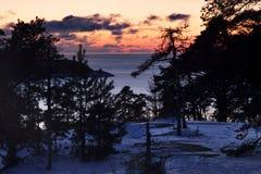 Finland: Vintersolnedgång Arkivbild