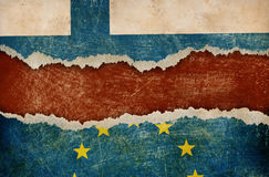 Finland withdrawal from European union fixit concept. European union and Finland flags on cardboard pieces Stock Photo