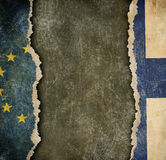 Finland withdrawal from European union fixit concept. European union and Finland flags on cardboard pieces Stock Images