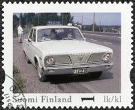 FINLANDIA - 2013: demostraciones Plymouth valeroso, coche policía oficial del vintage de Finlandia de la serie Fotos de archivo