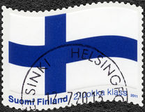 FINLANDIA - 2011: pokazuje Fińską flaga Błękitna krzyż flaga Fotografia Royalty Free
