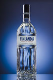 Finlandia vodka on blue gradient background. Royalty Free Stock Photo