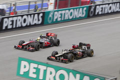 Lotusblomma Kimi Raikkonen overtakes McLaren Royaltyfria Foton