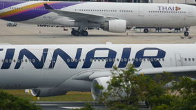 Finnair Airbus A330 is going to take off at Phuket International Airport stock footage
