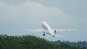 Finnair Airbus A330 takes off at Phuket International Airport stock video footage