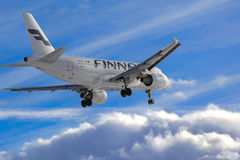 Free Finnair Airlines Airplane Landing To Airport Stock Images - 68645214