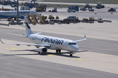 Finnair Embraer erj190 taxiing to gate at Vienna Airport Stock Photo