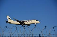 Finnair plane landing Royalty Free Stock Photo