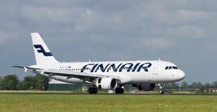 Finnarir. Finnair landing on Schiphol Airport Stock Images