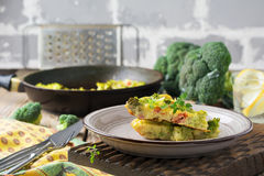 Finnis, omelet with broccoli, farel, potatoes and onions. Rustic style. Selective focus Royalty Free Stock Photography