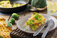 Finnis, omelet with broccoli, farel, potatoes and onions. Rustic style. Selective focus Royalty Free Stock Photo
