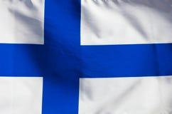 Finnische Flagge im Wind Lizenzfreies Stockfoto