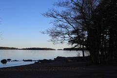 Finnish Beach during the Blue Hour. Sun is just about to be fully set and the nature is feeling the blue hour. You can see amazing tones of blue in both sky and stock images