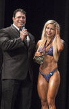 Finnish Beauty Captures toronto Pro Fitness Crown. Finnish beauty Piia Pajunen is congratulated by emcee Bob Cicherillo at the pro women`s fitness competition at Stock Images