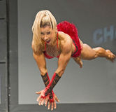 Finnish Beauty Captures toronto Pro Fitness Crown. Finnish beauty Piia Pajunen shows off her strength an agility, and flying ability at the pro women`s fitness Royalty Free Stock Image