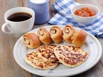 Finnish breakfast. With squeaky cheese Leipajuusto, mini cinnamon buns, cloudberry jam, and black coffee Stock Image