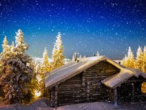 Finnish cabin during intense snowing backdrop. Hd horizontal nobody blank empty space sparse vivid vibrant bright color rich blue new year christmas winter star stock images