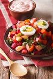 Finnish cuisine: rosolli salad and cream sauce close-up. Vertica Royalty Free Stock Photo