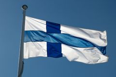 The Finnish Flag on a Flagpole. Waving in the wind with a blue sky royalty free stock photography