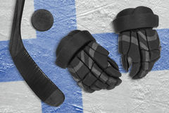 Finnish flag, hockey puck, stick and gloves Stock Images