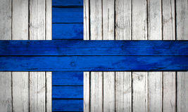 Finnish flag painted on wooden boards. Grunge style Royalty Free Stock Photos