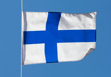 Finnish flag in the wind against a sky Royalty Free Stock Images