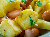 Finnish Fried potatoes with sausages Royalty Free Stock Photo