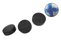 Finnish hockey pucks. Lined up in a row on white background Stock Image